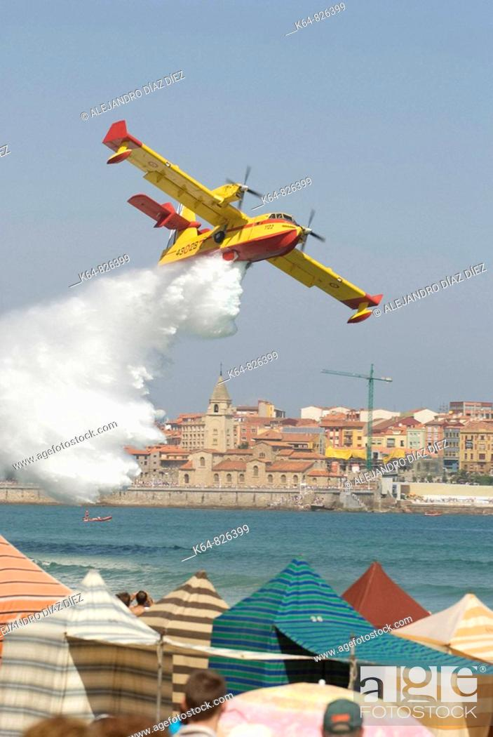 Stock Photo: Canadair waterbomber during airshow at Gijón beach, Spain.