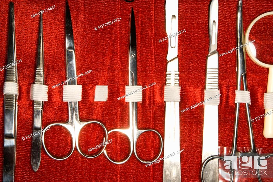 Stock Photo: Medical kit with tweezers, scissors, scapel.