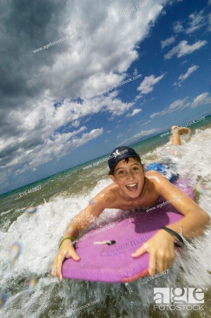 Stock Photo: Boy on boogie board.
