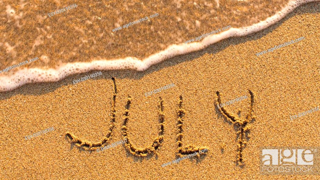 Stock Photo: Inscription JULY on a gentle beach sand with the soft wave (months of the year series).