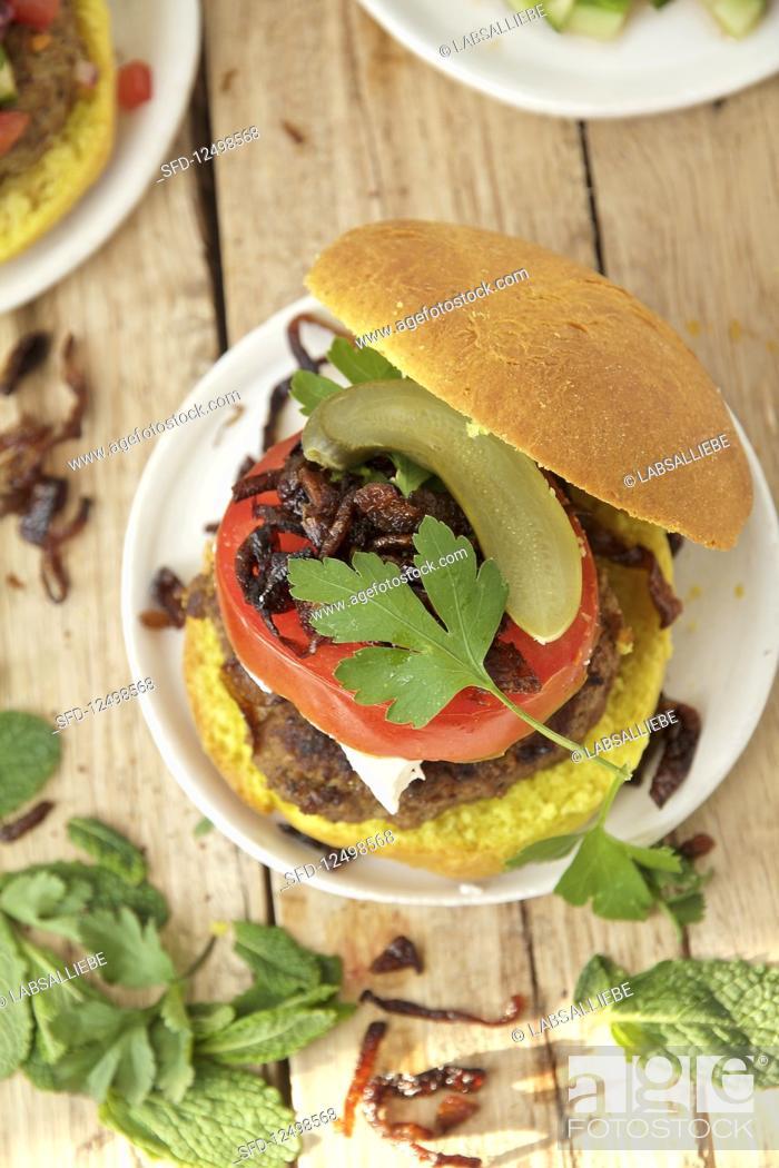 Stock Photo: A juicy kebab burger.