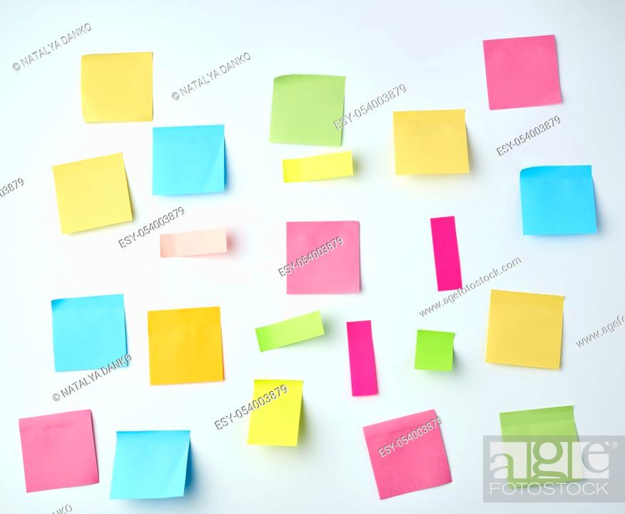 Stock Photo: multicolored blank paper stickers of different sizes and shapes on a white background.