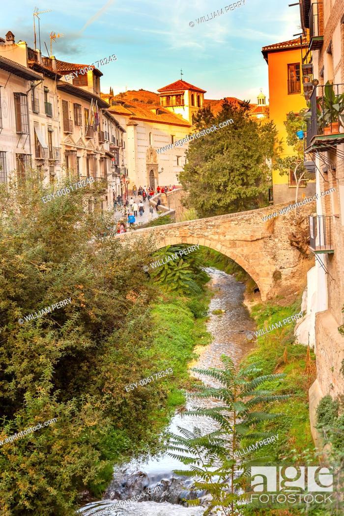 Stock Photo: Old Bridge River Rio Darro Walking Street Evening Carrera Del Darro Albaicin Granada Andalusia Spain.
