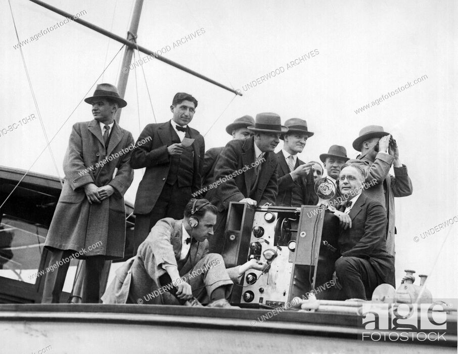 """Stock Photo: New York, New York, 1925 Testing equipment on the yacht """"""""Elce"""""""" from which the Childs Cup Rowing Regatta on the Harlem River will be broadcast to the nation by."""