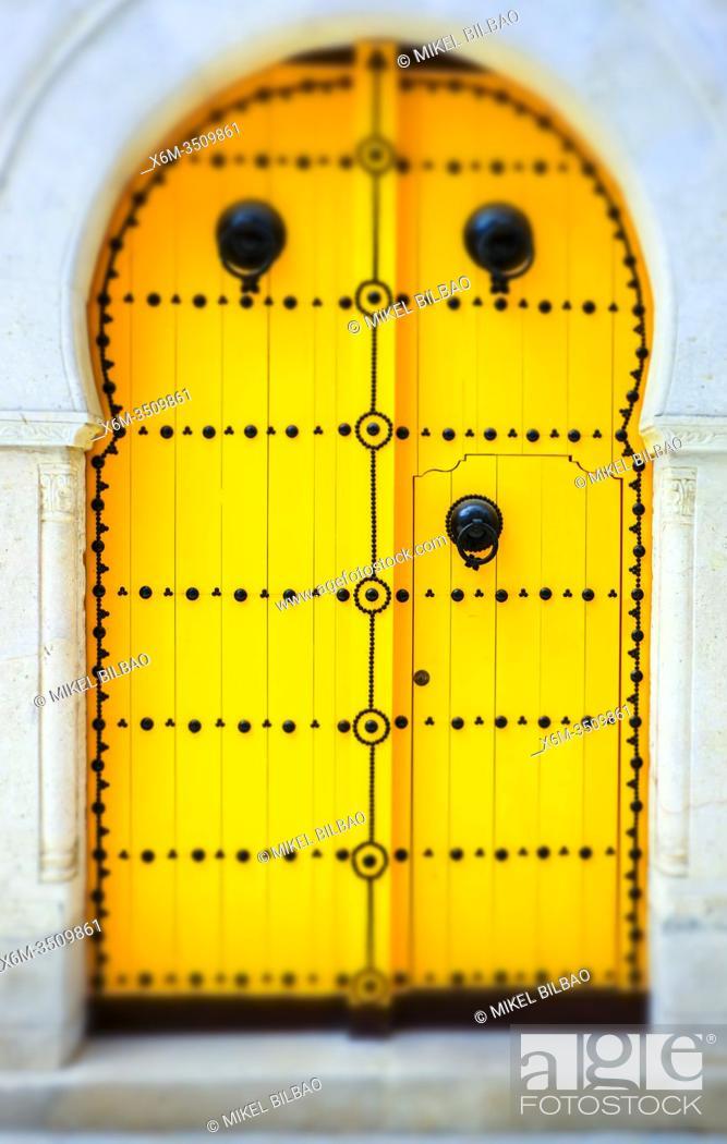 Stock Photo: Spiked wooden door in the medina. Tunis city. Tunisia, Africa.