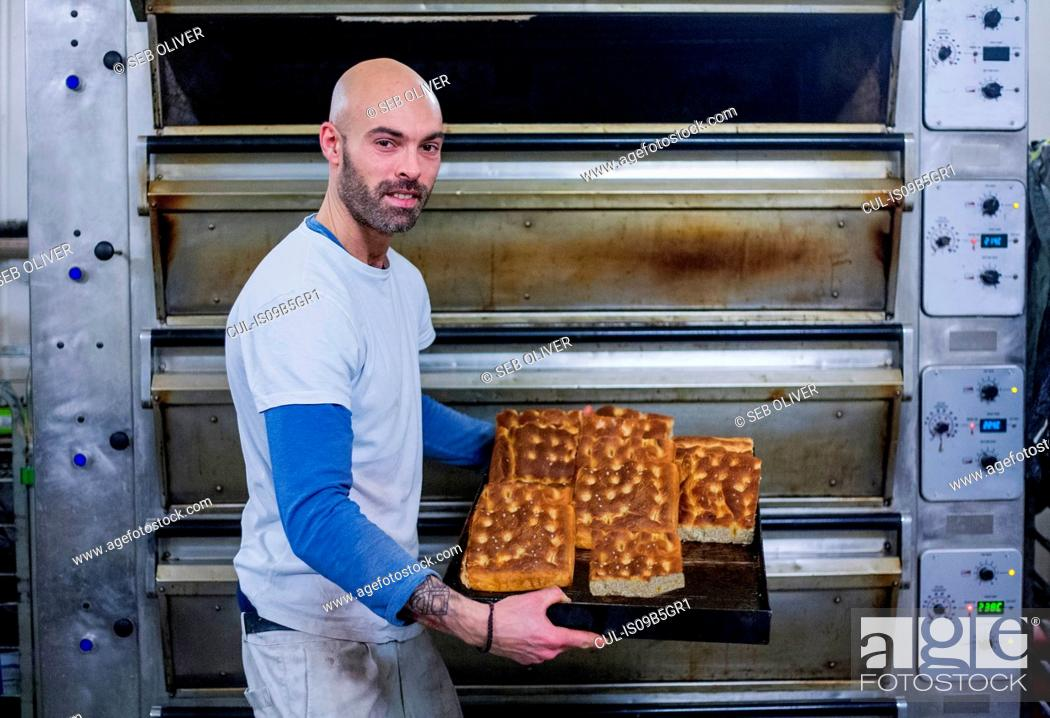 Stock Photo: Baker with freshly-made focaccia.