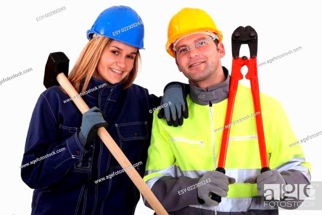 Photo de stock: Male and female manual workers.