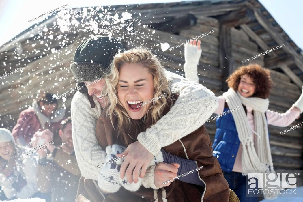 Stock Photo: Friends enjoying snowball fight.