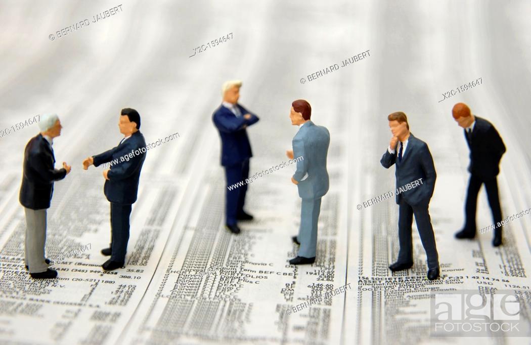 Stock Photo: Miniature figurines on stock-market prices.