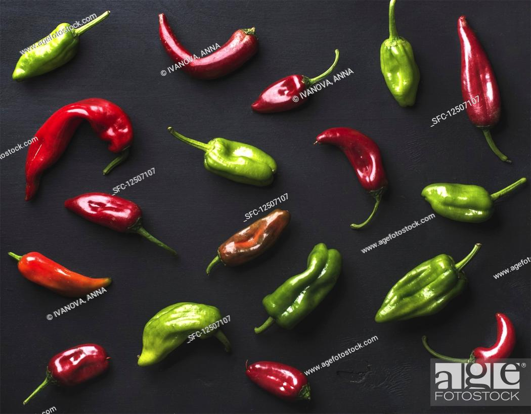 Stock Photo: Pattern of small colorful hot chili peppers.