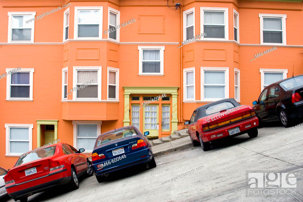 Stock Photo: Cars parked in front of a bright, well-maintained orange house on a very steeply sloped section of Jones Street in San Francisco, California.