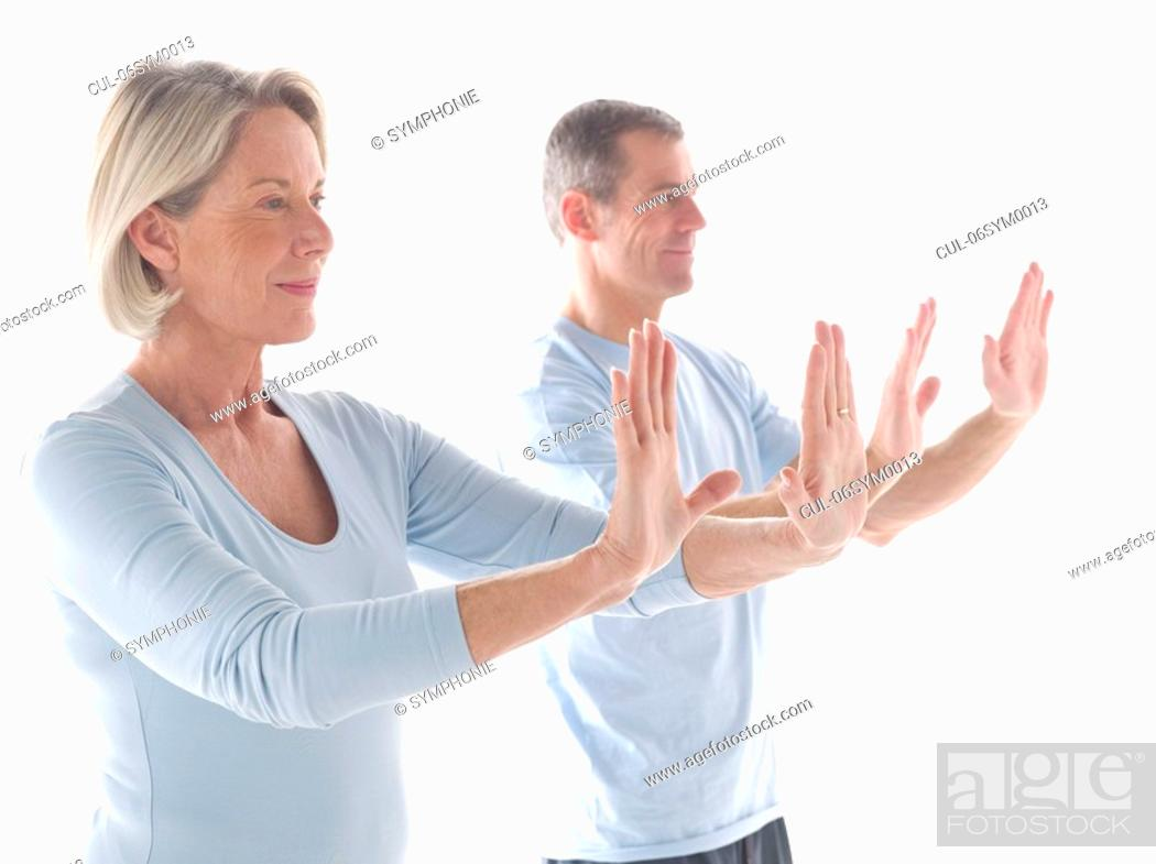 Stock Photo: Mature couple doing yoga.