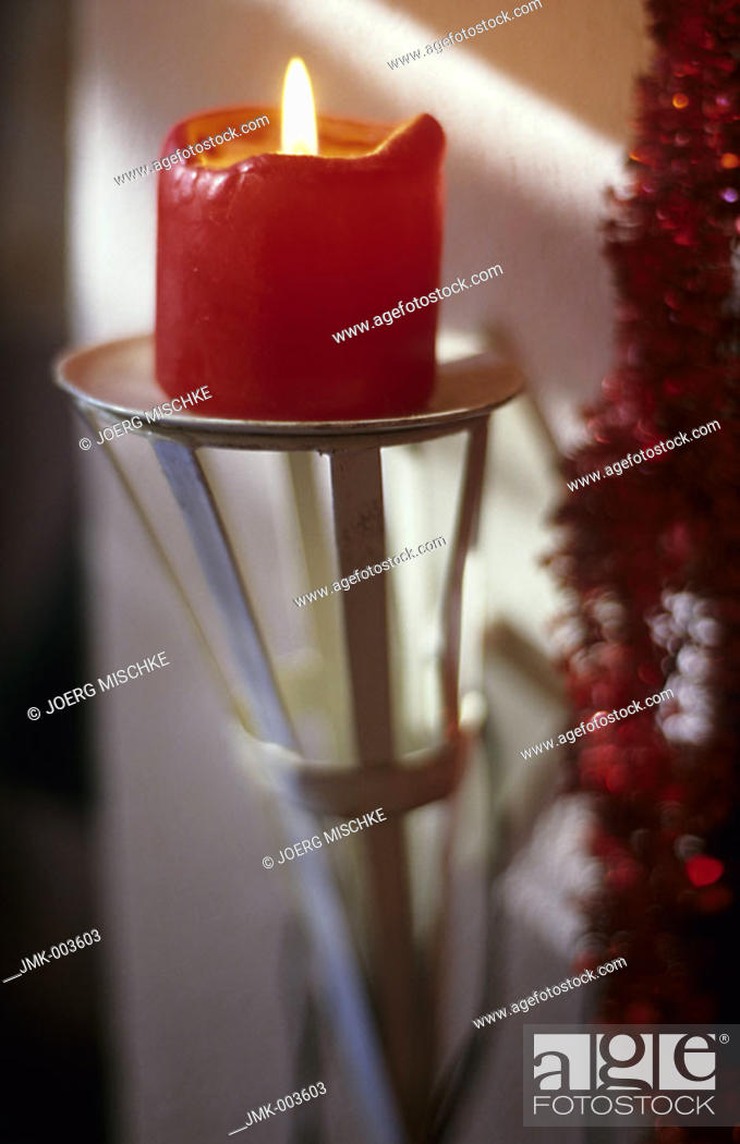 Stock Photo: A burning candle on a candlestick.