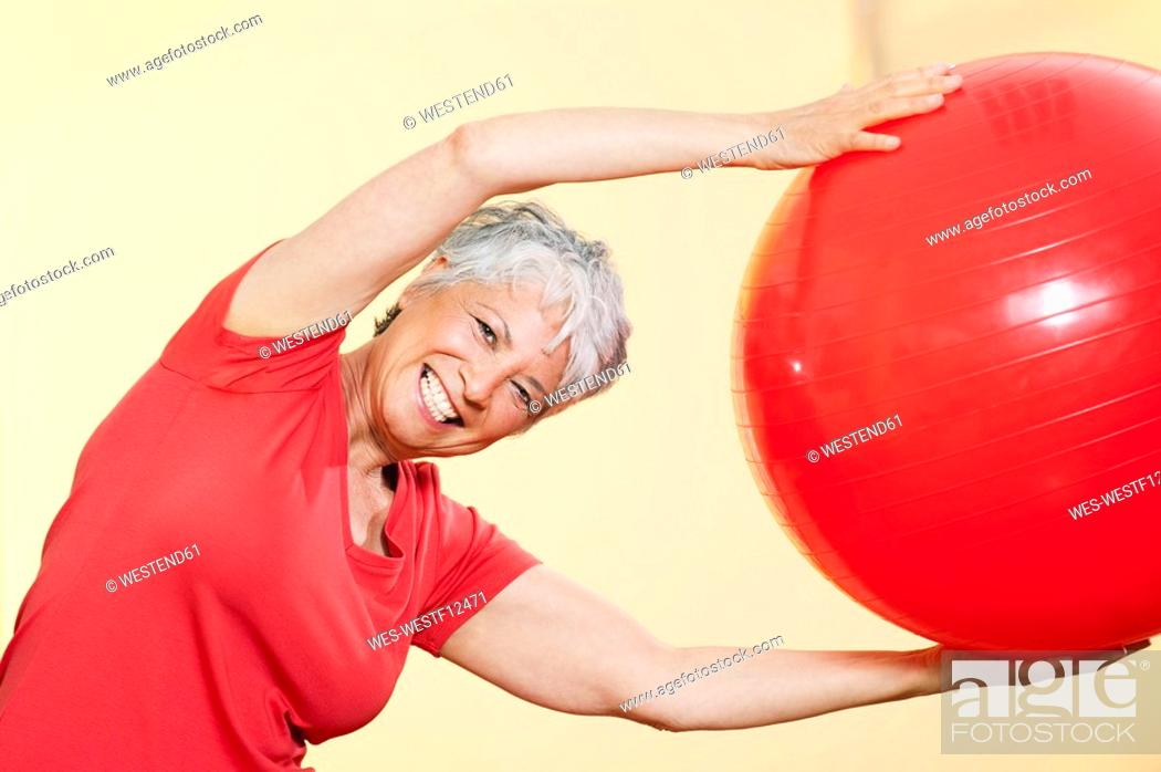 Stock Photo: Senior woman practicing with gymnastic ball.