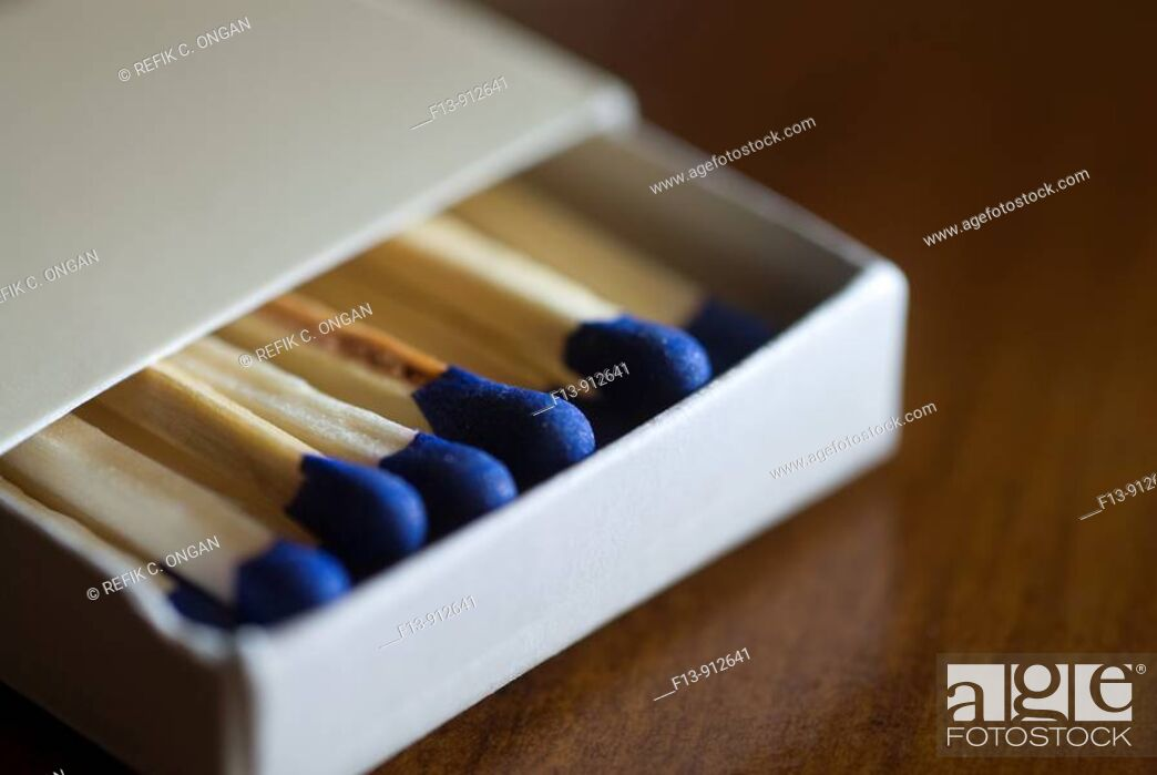 Stock Photo: match box on table.