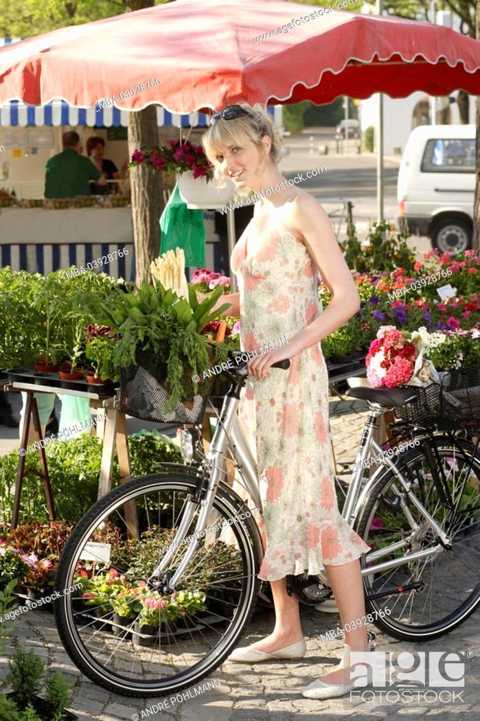 Stock Photo: Week-market, woman, bicycle, basket, detail, buys series, people, customer, blond, summer-dress, wheel, purchase-basket, vegetables, herbs, chooses, selects.