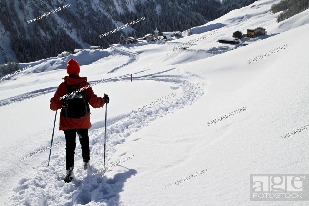 Stock Photo: Hiker on the way to snowy village.