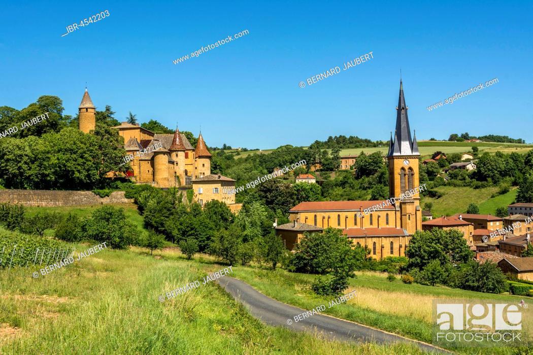 Stock Photo: Castle and church of Jarnioux, Village of Pierres Dorées, Beaujolais, Rhone, Auvergne-Rhône-Alpes region, France.