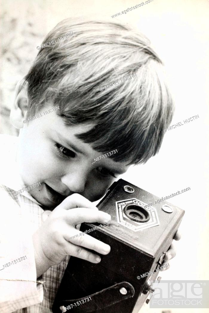 Stock Photo: curiosity of a child&39, s old camera.