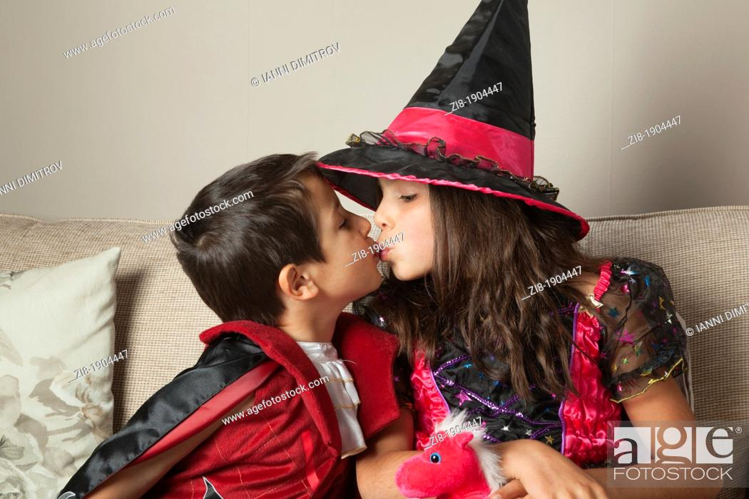 Stock Photo: Children kissing on Halloween party.