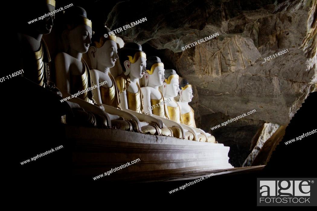 Stock Photo: Rows of Buddha statues in Kawgoon cave, Hpa-An, Burma.