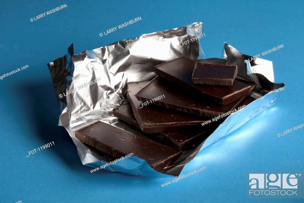 Stock Photo: A stack of chocolate in foil packaging.