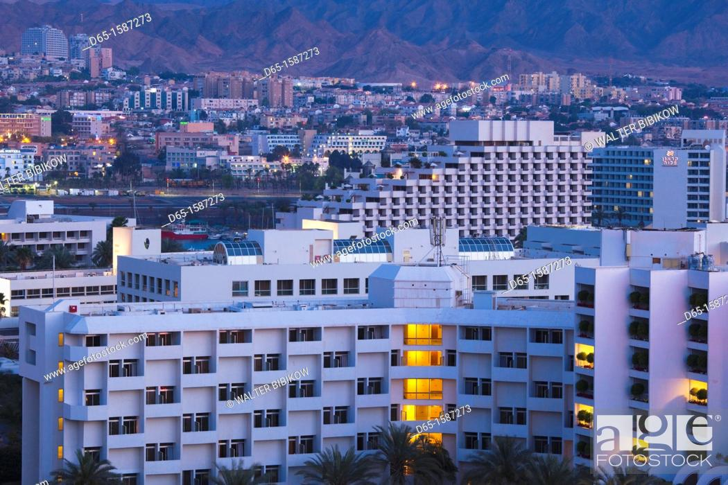 Stock Photo: Israel, The Negev, Eilat, elevated view of Red Sea resort, dawn.