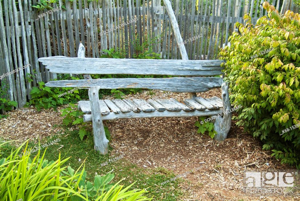Stock Photo: Wooden bench in a garden on Hornby Island, BC, Canada.