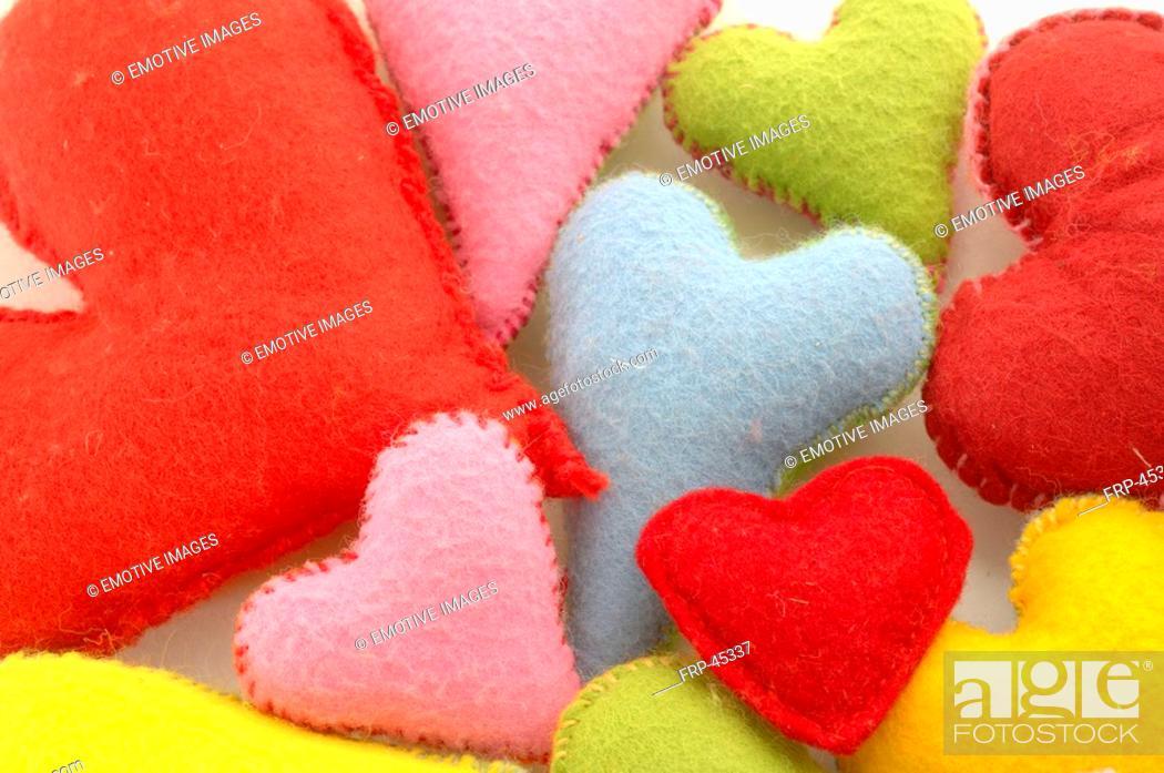Stock Photo: multicoloured decorative hearts.