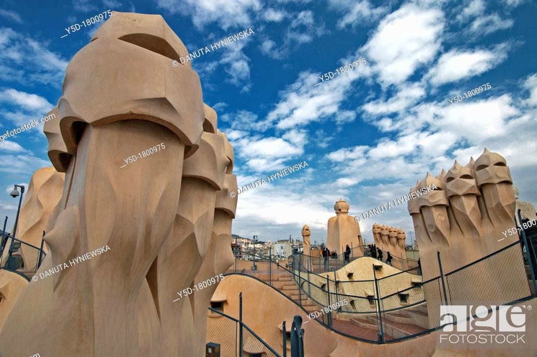 Stock Photo: Aliens like vent outlets on the roof of Casa Milà building known as La Pedrera, designed by Catalan famous architect Antoni Gaudi, Passeig de Gràcia, Barcelona.