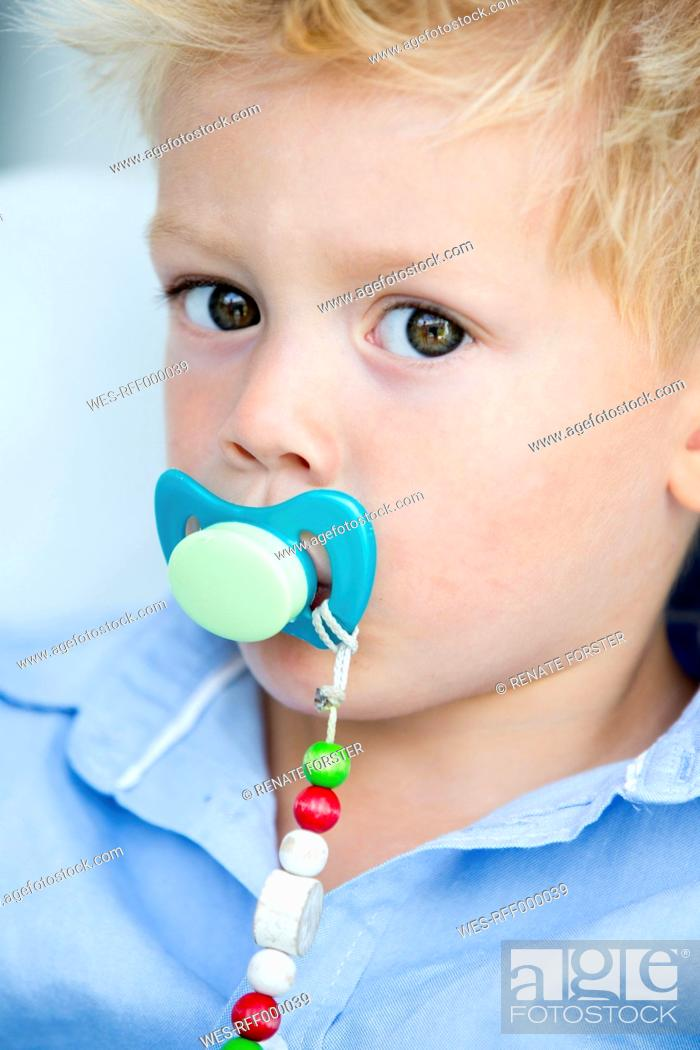 Stock Photo: Germany, Portrait of boy with pacifier.