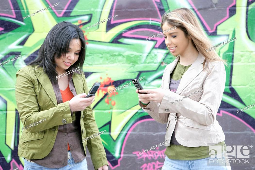Stock Photo: View of two women with cellphone.