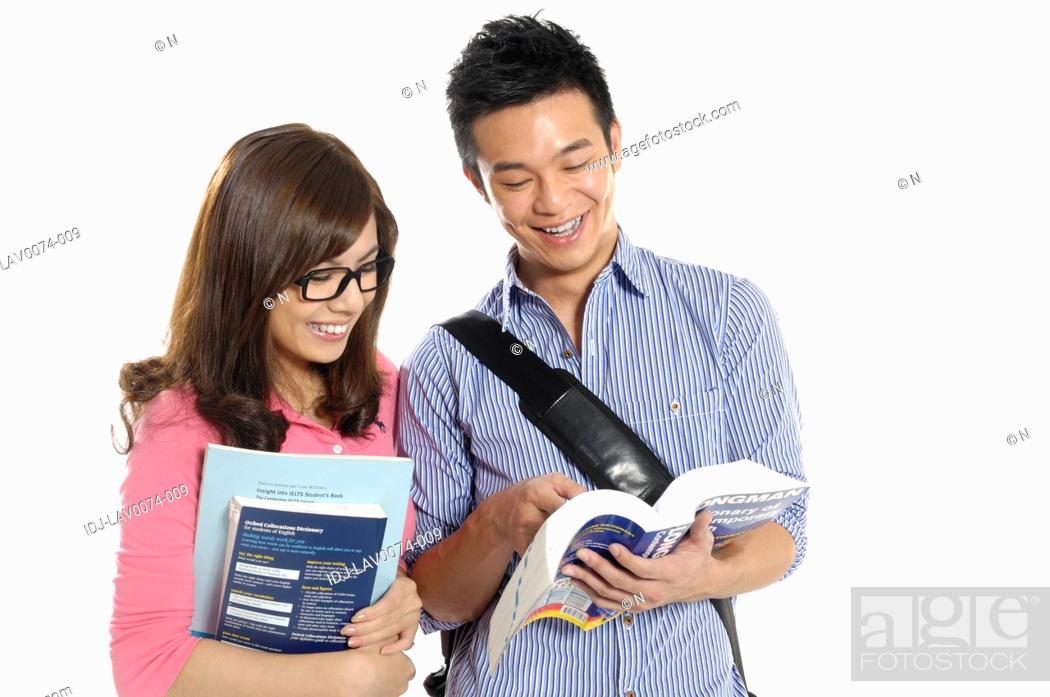 Stock Photo: University students studying together and smiling.