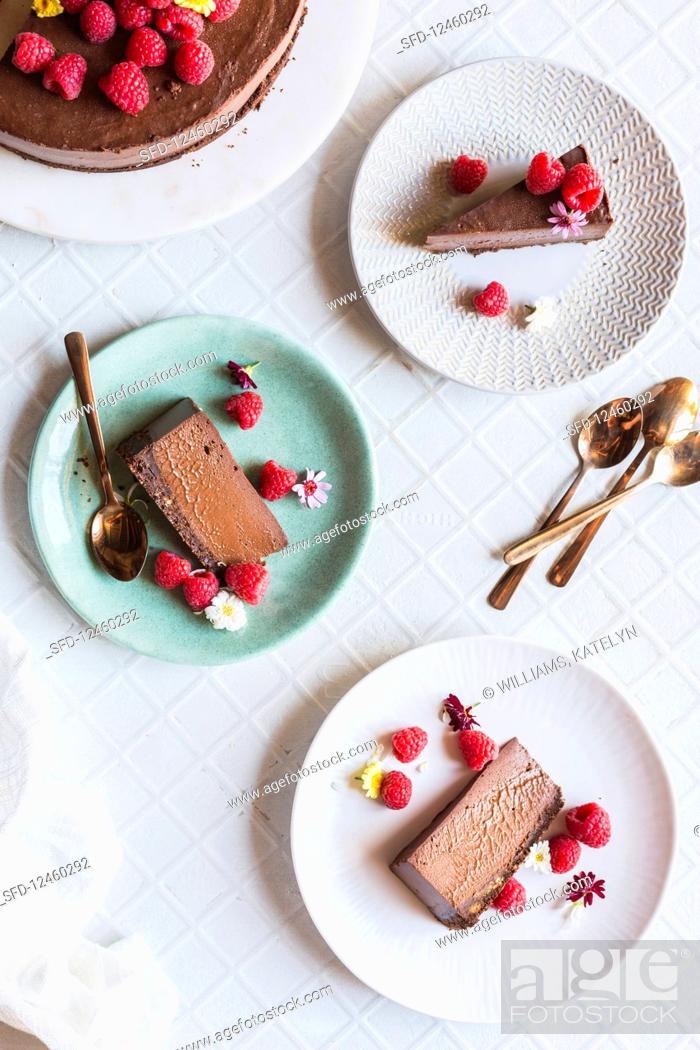 Stock Photo: Chocolate Cheesecake with raspberries.