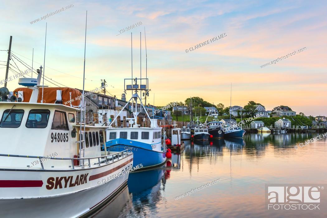 Stock Photo: Commercial fishing boats docked in Menemsha Basin under a colorful pre-sunrise sky, in the fishing village of Menemsha in Chilmark.