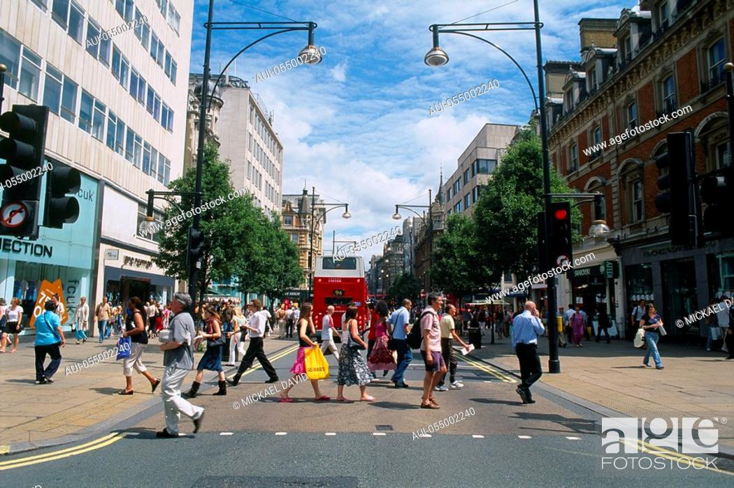 Stock Photo: England - London - Soho district - pedestrians crossing the road.