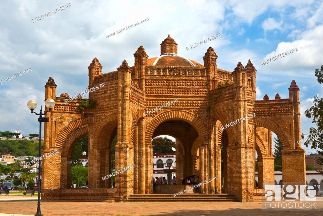 Stock Photo: Facade of a building in a park, La Fuente Colonial, Chiapa De Corzo, Chiapas, Mexico.