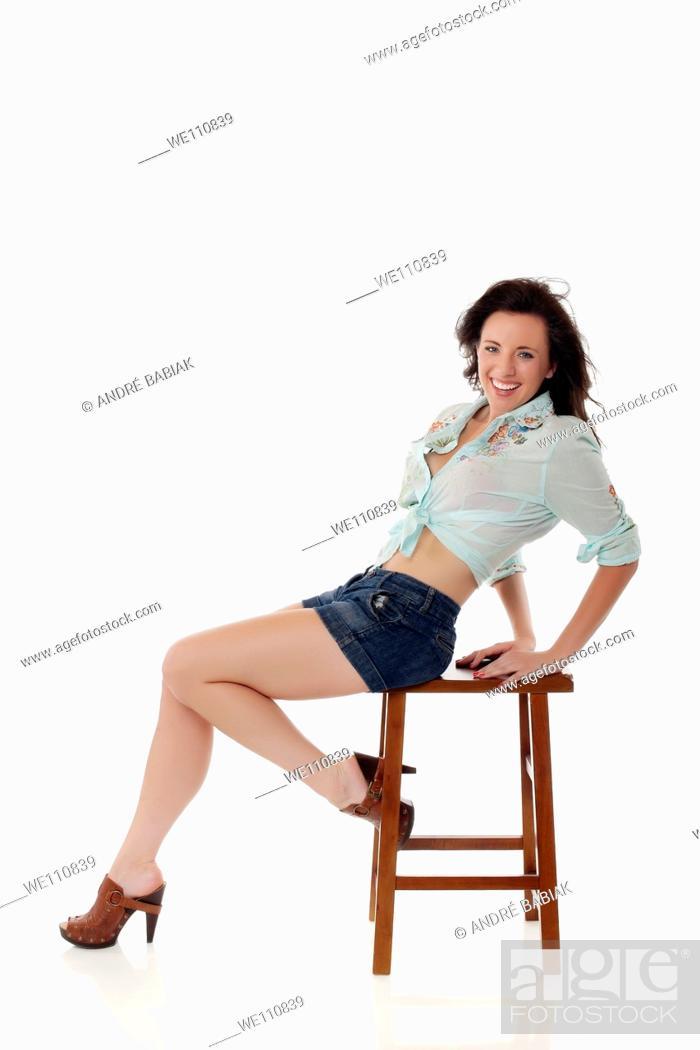 Stock Photo: Attractive woman posing on stool.