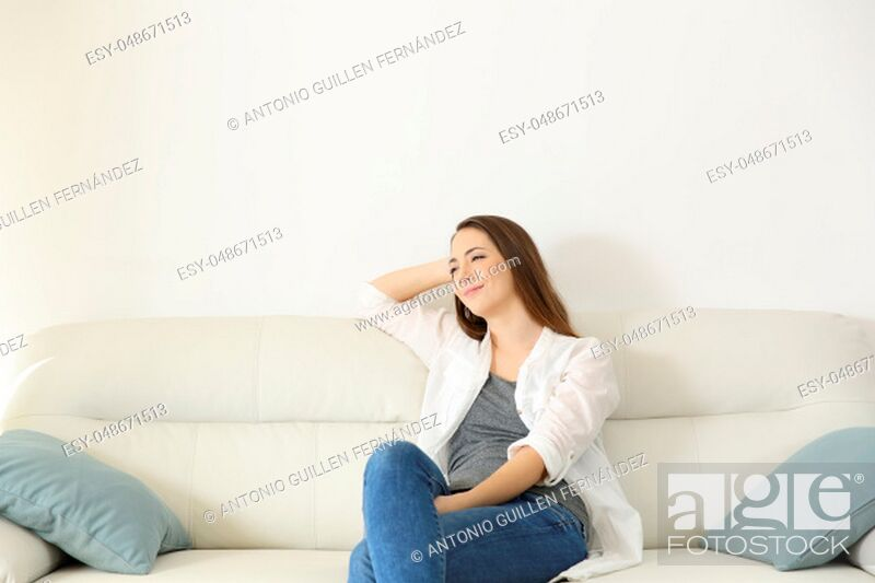 Stock Photo: Wide angle view portrait of a woman resting in a couch with copy space above.