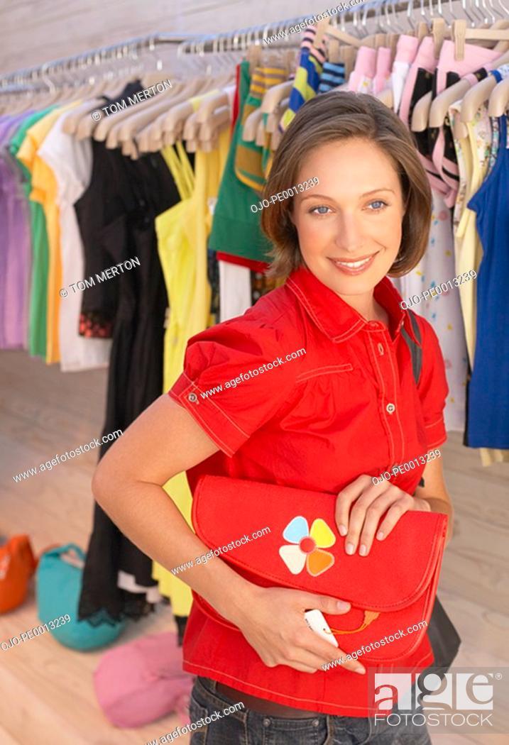 Stock Photo: Woman shopping for handbag.
