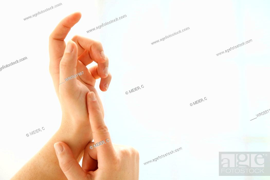 Stock Photo: two well-groomed hands in front of white background.