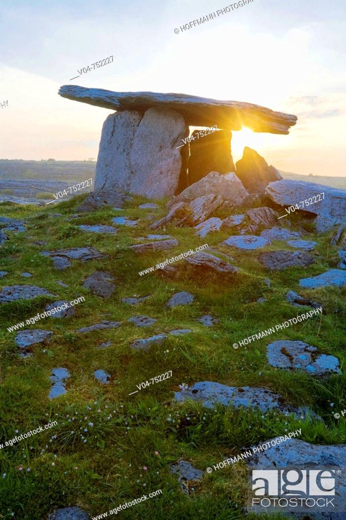 Stock Photo: Poulnabrone Megalithic Tomb with rising sun in the Burren, Ireland, Europe.