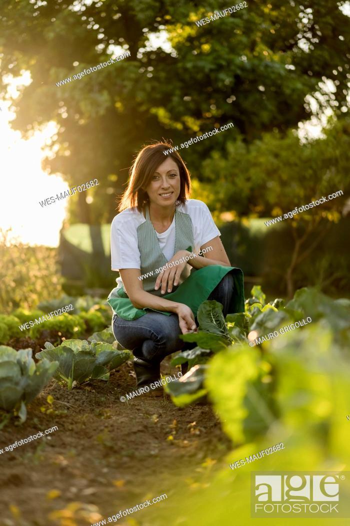 Stock Photo: Woman working in her vegetable garden.