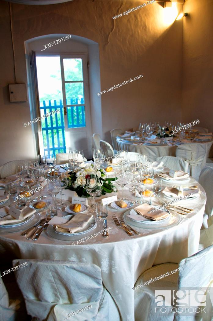 Stock Photo: Indoor wedding dinner table place setting.