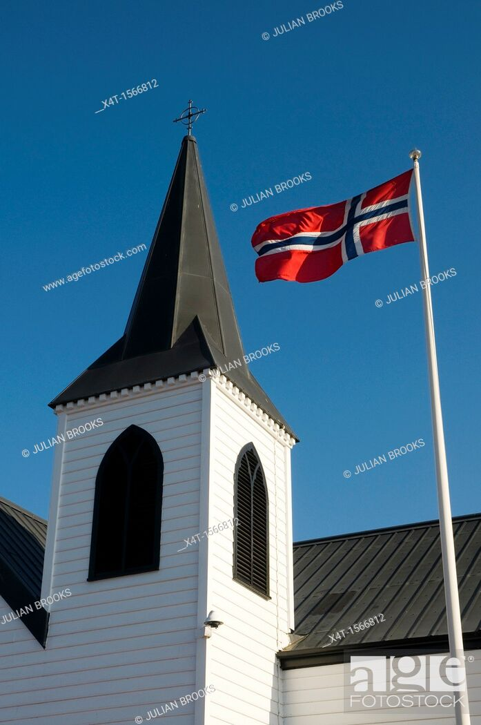 Stock Photo: The Norwegian flag and the Norwegian church, Cardiff Bay, Wales.