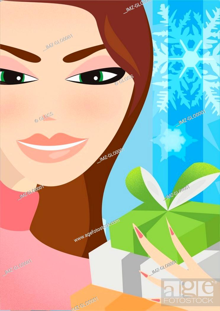 Stock Photo: A woman holding wrapped gifts.