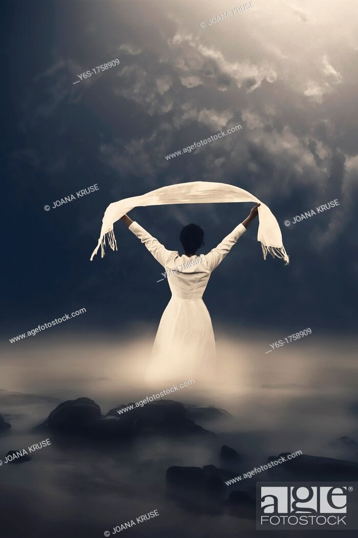 Photo de stock: a woman in a white dress is coming out of the misty water.