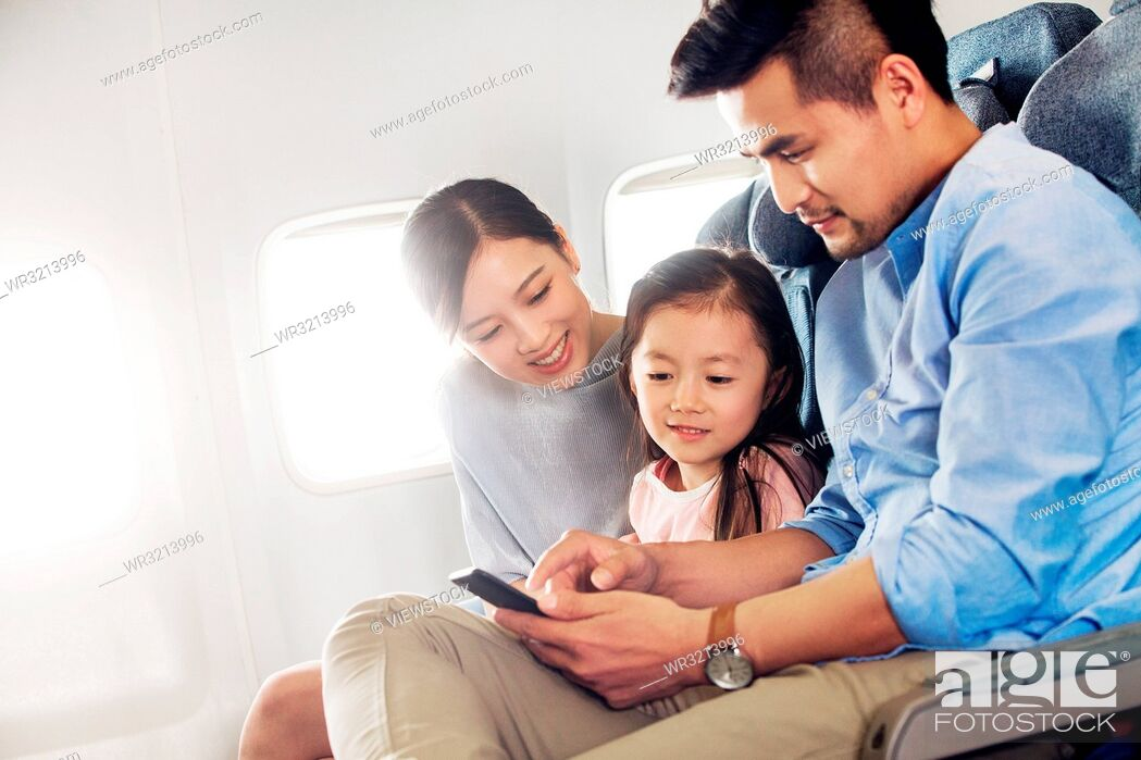 Stock Photo: Happy families by plane.