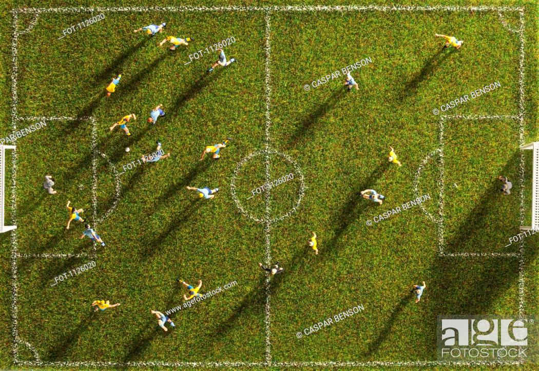 Stock Photo: Miniature figurines of two soccer teams playing a soccer match, directly above.