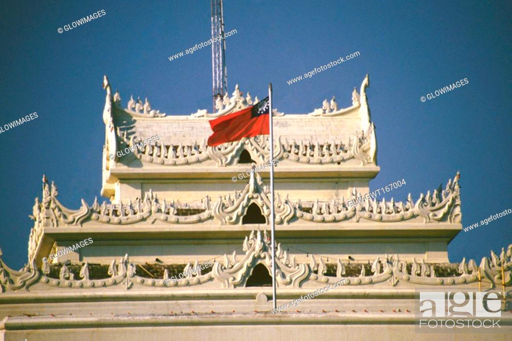 Stock Photo: National flag fluttering on a city hall, Yangon, Myanmar.